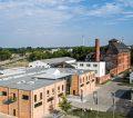 Teltomalz Backmischungen Mischbetrieb mit dem alten Biomalz-Gebäude und dem modernen Fabrikationsgebäude der Teltomalz GmbH